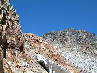 Gothic Peak summit ahead as seen while scrambling through some rock bands.