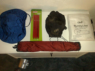 REI Elements rain hat, Coleman MSR copy stakes, 3 sets of 4, My old dirty OR gaiters, one snap missing on the top but they work fine, Design Salt mummy bag liner, never used, Big Agnes chair kit