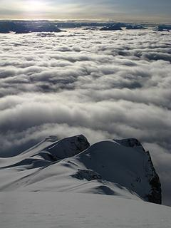 Clouds fill the lower elevations