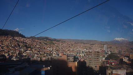 Riding the $0.50 gondola up the hill above La Paz