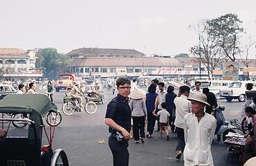Near the Saigon Central Market.  Then, as now, always a camera at the ready.