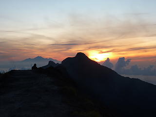 Sunrise and the summit of Gunung Agung, Bali highpoint at 9944.'. Rinjani, the highpoint of Lombok behind.
