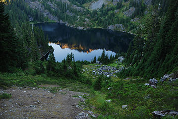 View from the east ridge above Lake Lillian with the alpenglow reflection in the water.
