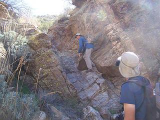 Daniel climbs a dry waterfall